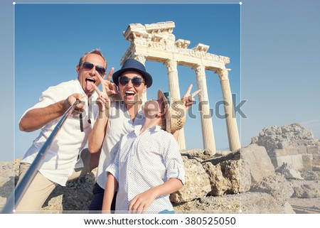 Funny family take a selfie photo on Apollo Temple colonnade view in Side, Turkey - stock photo