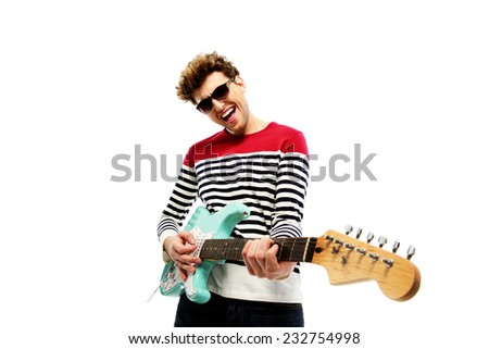 Funny fashion man playing on the guitar on a white background - stock photo
