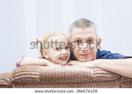 funny father and her daughter - stock photo