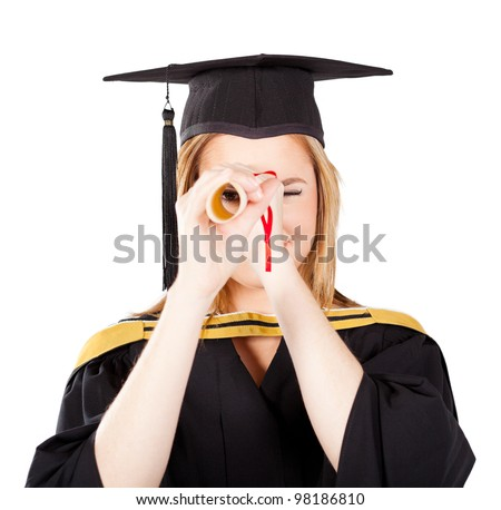 funny female graduate looking through her certificate - stock photo