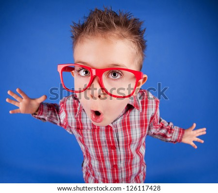 Funny five years old boy with expressive face, misbehave concept - stock photo