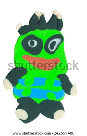 funny flat green monster made from plasticine on isolated background - stock photo