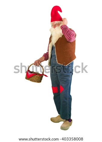 Funny garden gnome on white holding a wicker basket - stock photo