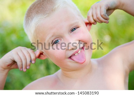 funny ginger boy poses and shows faces language - stock photo