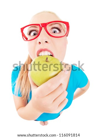 Funny girl biting an apple isolated on white, taken by fish eye lens - stock photo