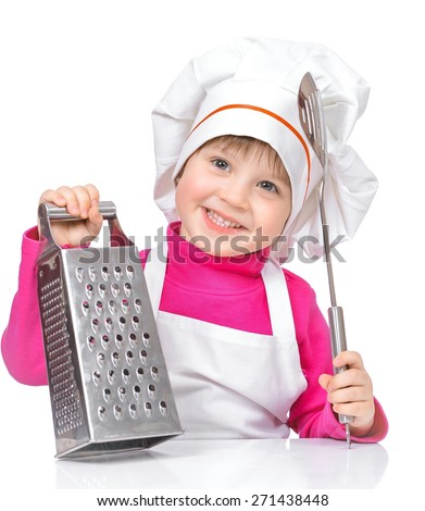 funny girl chef with kitchen grater at the table, isolated on a white background. - stock photo