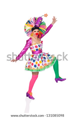 Funny girl clown with a big colorful wig dancing isolated on white background - stock photo