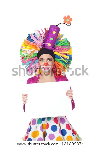 Funny girl clown with a blank advertising for text isolated on white background