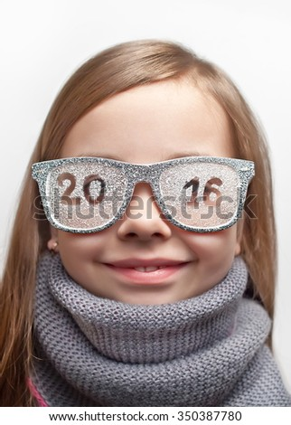 Funny girl in funny glasses and a scarf with the inscription 2016 - stock photo