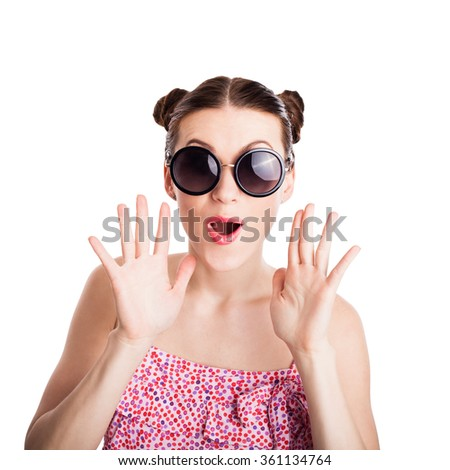funny girl in sunglasses with expression of surprise - stock photo