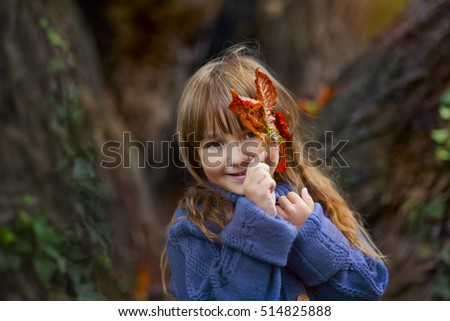 Funny girl portrait with chestnut leaves