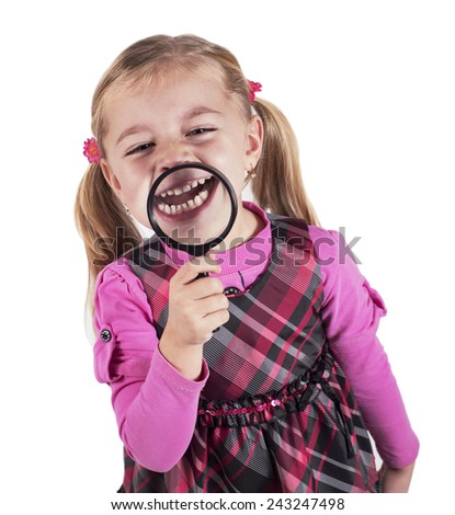 Funny girl showing teeth through a magnifying glass, isolated on white - stock photo