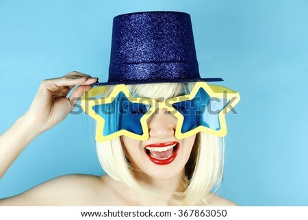 Funny girl wearing star shaped glasses, Playful girl with funny glasses, Happy naughty blonde hair woman with Large glasses. Party time. (Vintage Style Color) - stock photo