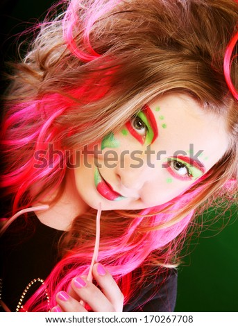funny girl with crazy make-up - stock photo