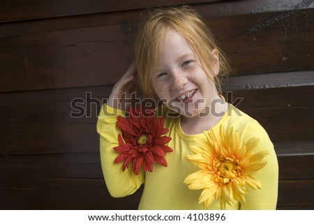 funny girl with freckles and flowers