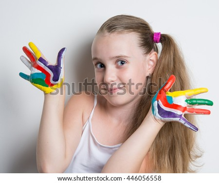 funny girl with painted bright palms