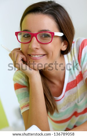 Funny girl with pink eyeglasses - stock photo