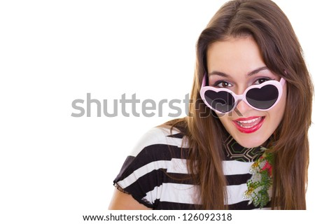 Funny girl with pink heart glasses isolated on white - stock photo