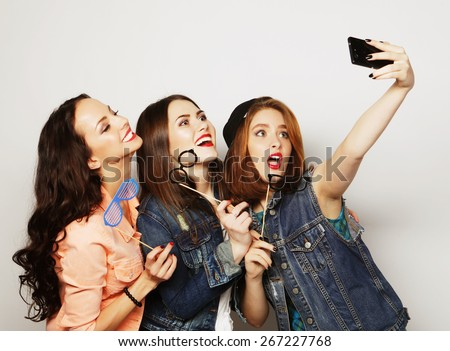 funny girls, ready for party, selfie - stock photo