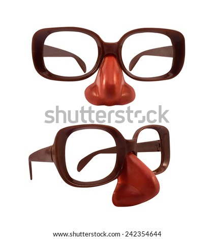 Funny glasses. Isolated funny toy clown glasses with red plastic nose photo. - stock photo