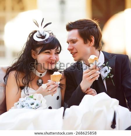 Funny gothic couple eating ice-creame happy - stock photo