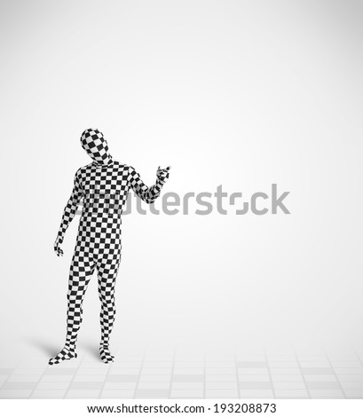 Funny guy in morphsuit body suit looking at empty copy space
