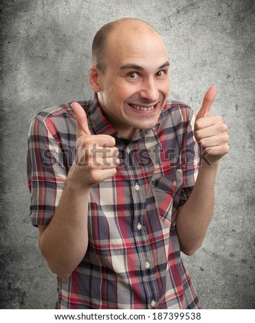 Funny guy showing his thumbs up - stock photo
