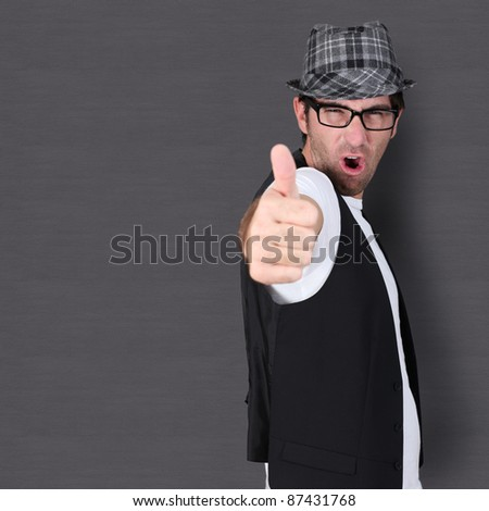 Funny guy showing thumb up - stock photo