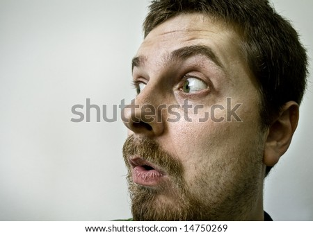 Funny guy with a surprised expression on his face - stock photo