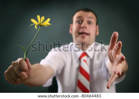 funny guy with yellow flower (focus on flower)