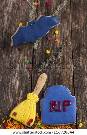 Funny Halloween cookies on old style wood table - stock photo