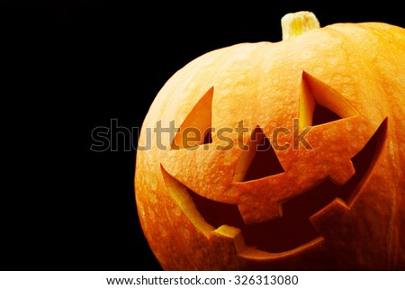 Funny Halloween Jack O' Lantern pumpkin on black background - stock photo