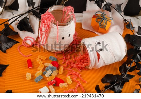 Funny Halloween party decoration with assorted candy - stock photo