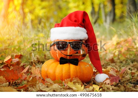 Funny Halloween. Pumpkin with glasses and a Smoking pipe. Happy Xmas!