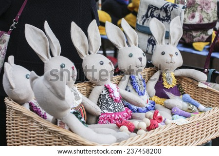 funny handmade Easter rabbits in a market - stock photo