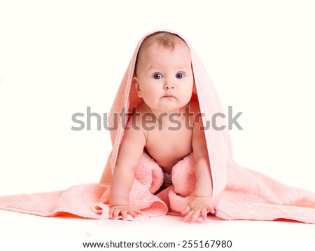 Funny happy baby girl in pink towel