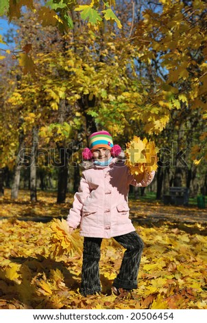 Funny happy child in autumn park