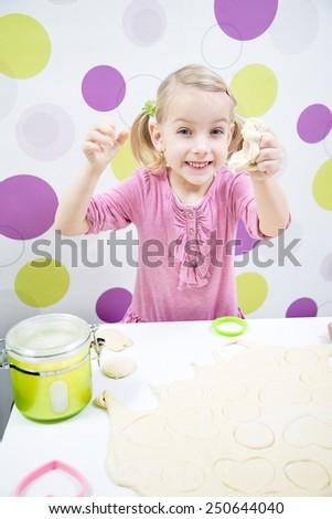 Funny happy girl make cake - stock photo