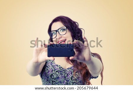 Funny happy lady with a smartphone - stock photo