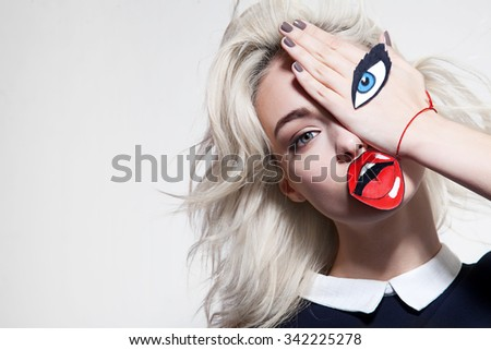 funny hipster girl posing for the camera - stock photo
