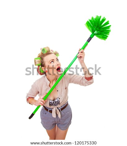 Funny housewife / girl with broom, isolated on white. Above shot of a domestic woman - stock photo