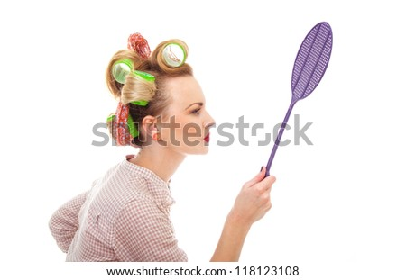 Funny housewife / girl with fly swatter, isolated on white. Close-up from side / profile - stock photo
