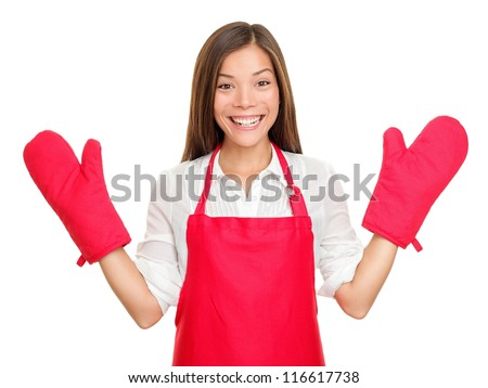 Funny housewife woman with oven mittens and red apron isolated on white background. Beautiful smiling excited mixed-race Caucasian / Asian Chinese young woman. - stock photo