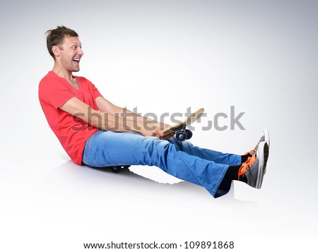 Funny humorous man on skateboard - stock photo