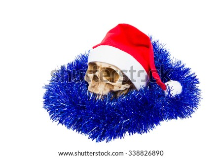 Funny humorous skull in hat Santa Claus isolated on white background. - stock photo