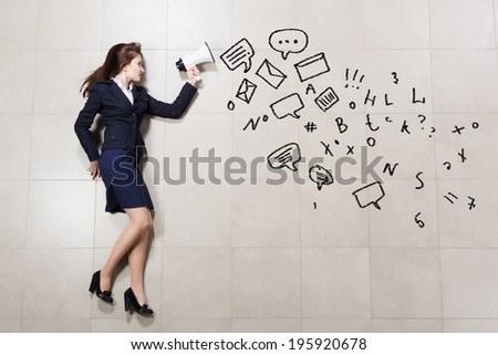 Funny image of businesswoman running with megaphone in hands - stock photo