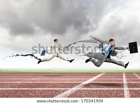 Funny image of young businesspeople running at stadium