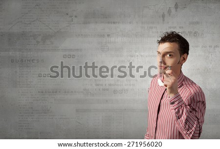 Funny image of young man looking in magnifying glass - stock photo