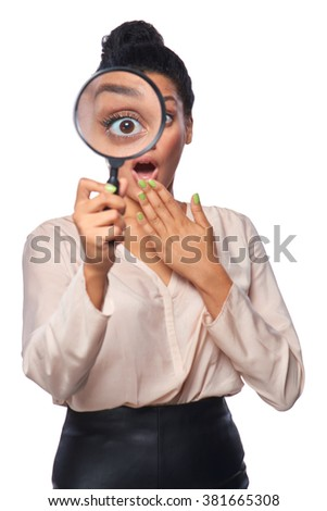 Funny image of young surprised female looking at the camera through a magnifying glass, isolated on white background - stock photo