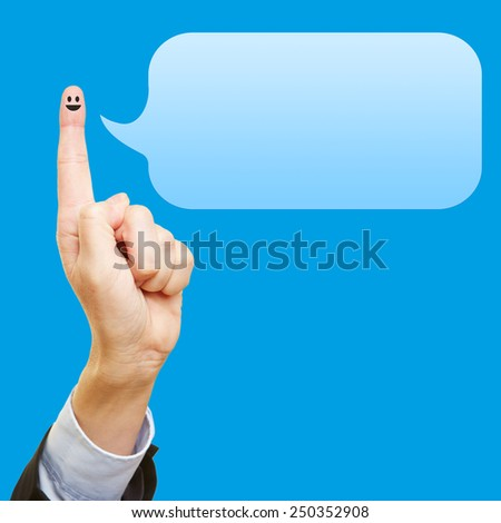 Funny index finger with smiley and an empty blue speech bubble - stock photo